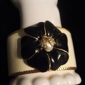 Cuff bracelet with flower and ladybug